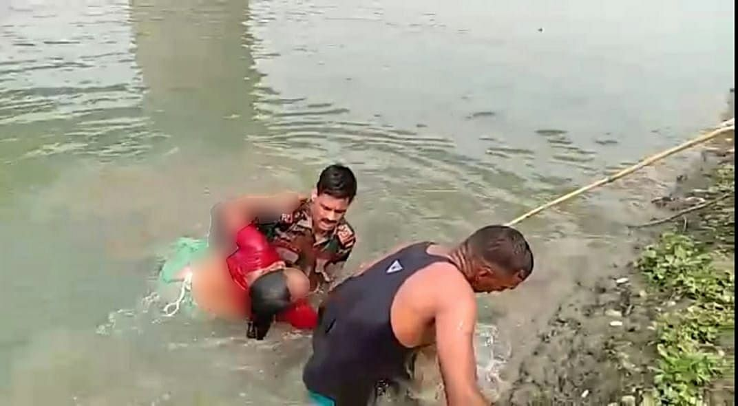 The woman being pulled out of Nausatra Nallah in Barpeta, Assam