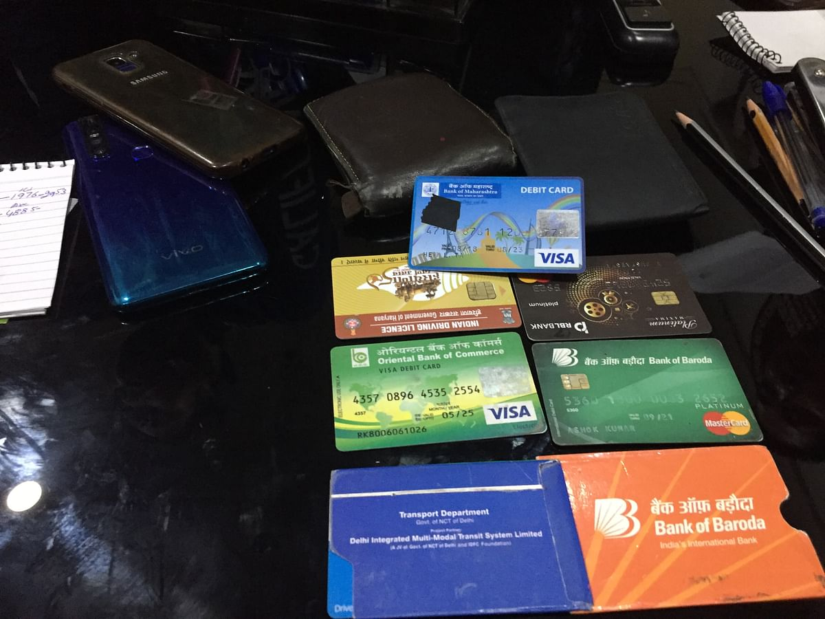 Various articles, including mobile phones and ATM cards, were found from the possession of the accused
