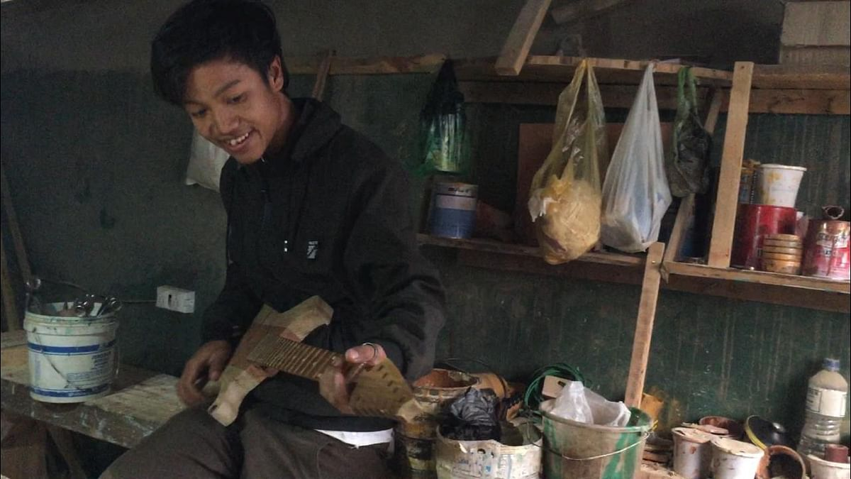 Meghalaya's Pynthymme Pale, 20, with his electric guitar carved from wood
