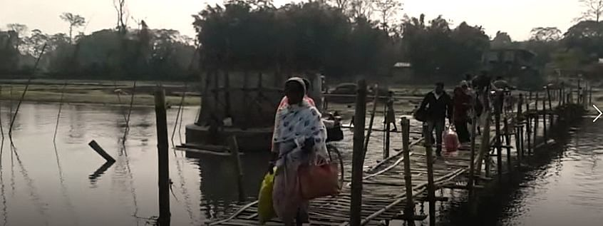 Daily commuters risking their lives to cross the Puthimari river over a makeshift bamboo bridge in Assam's Baksa district