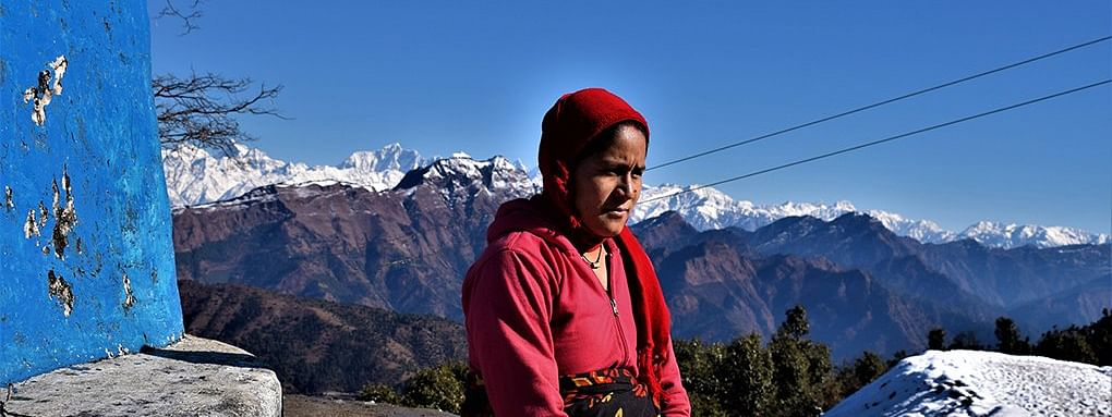 In a village close to the transboundary Mahakali river, a pregnant woman awaits news of remittance from her husband working abroad