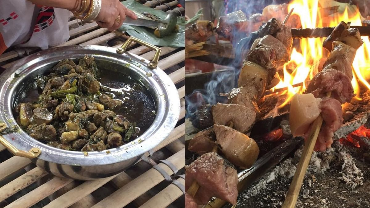 Various pork dishes being prepared at the Murong Okum in Guwahati as part of Ali Aye Ligang festival of the Mising community in Assam