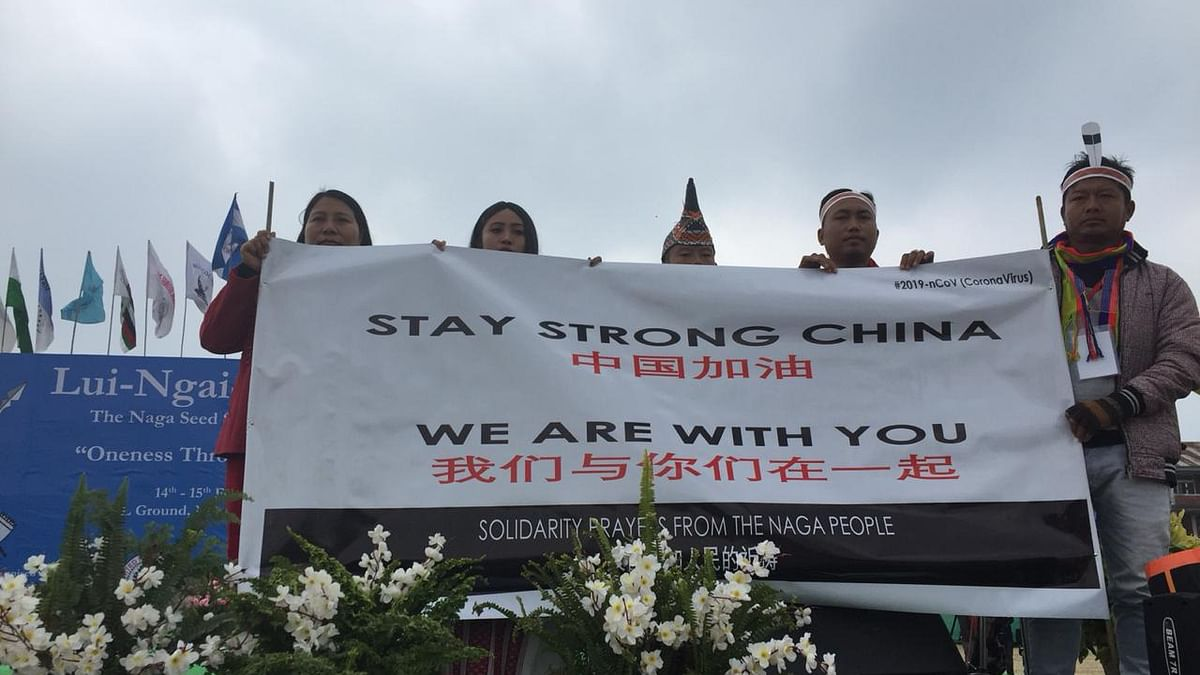 Participants of Lui-Ngai-Ni festival in Manipur's Ukhrul district holding a placard that says 'Stay strong China, we are with you'