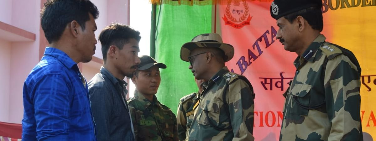 NLFT militants surrendering before BSF in Gomati district on Tuesday