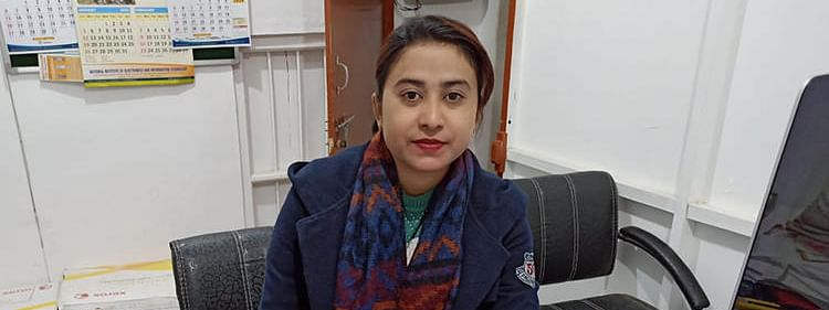 Journalist Babie Shirin is pictured in the office of the Imphal Free Press newspaper