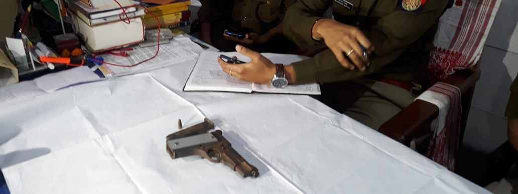 The recovered items include a pistol with a magazine and a live 7.65 mm ammunition