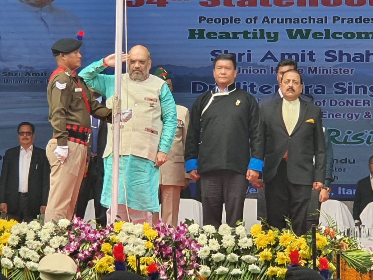 Union minister Amit Shah, Arunachal CM Pema Khandu and DoNER minister Jitendra Singh unfurling the national flag during Statehood Day celebrations