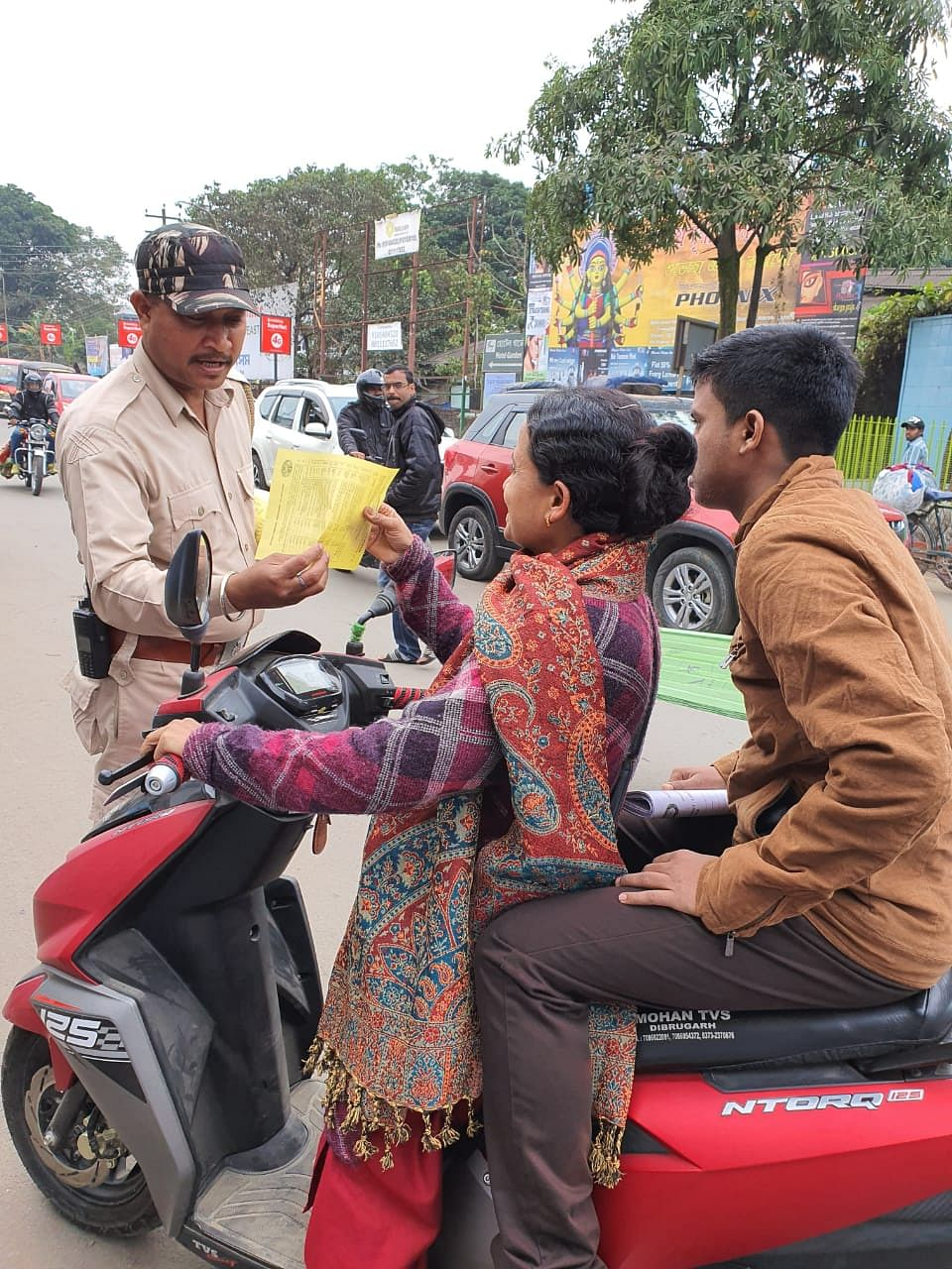 Dibrugarh police distributing leaflets among the riders