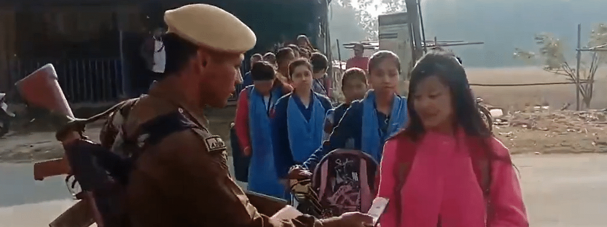 In a video which is doing the rounds of social media, policeman Ratul Gogoi is seen wishing the candidates of HS exams all the best and distributing  pens