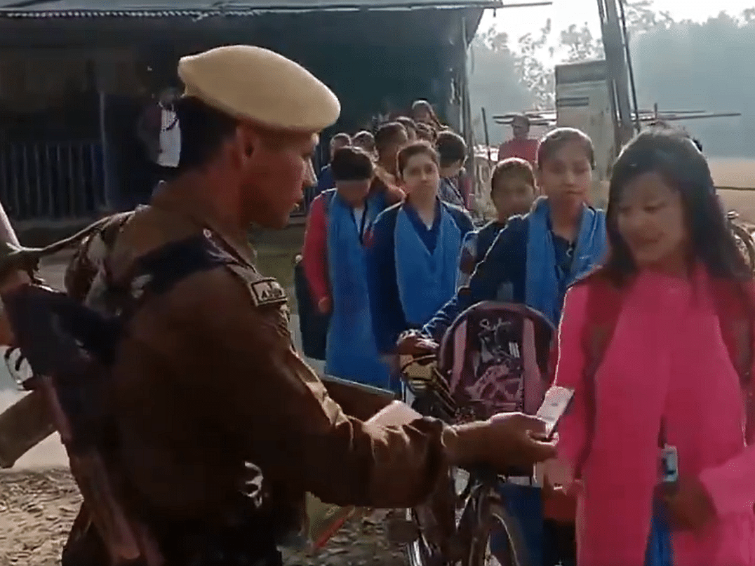 Salute! Assam cop greets Class XII Board exam candidates with pens