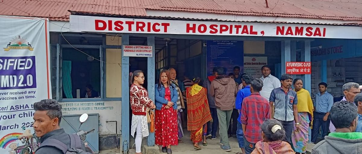 Family members and relatives gather outside the district hospital in Namsai