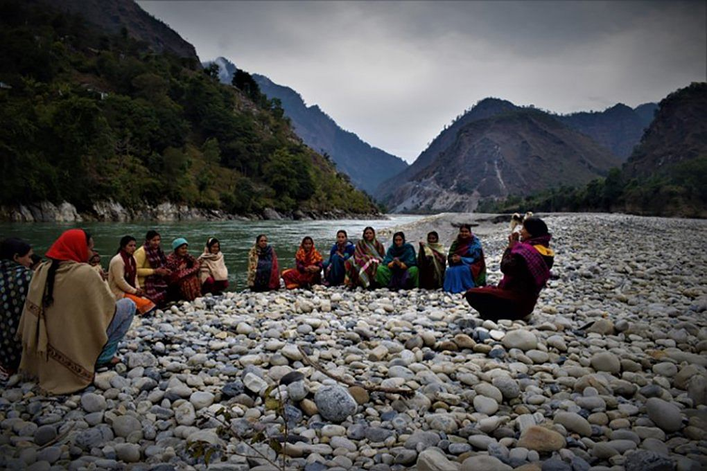 A Women's Empowerment Committee meeting on the Mahakali riverbed