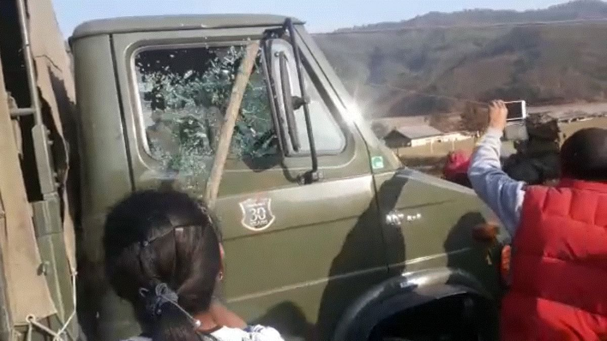Locals allegedly vandalising an Assam Rifles vehicle in Mayangkhang area of Manipur's Senapati district on Friday