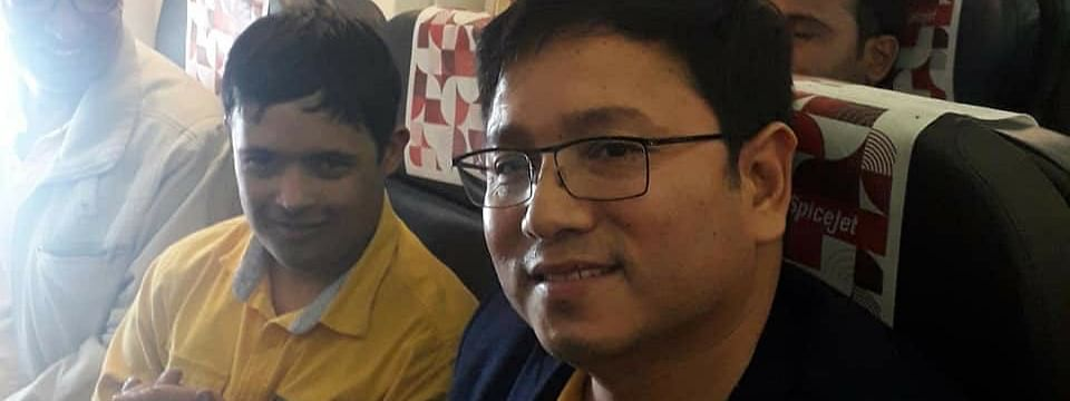 Dr Jego Ori (right) with the young passenger that he helped on board a SpiceJet flight from New Delhi to Guwahati on Friday