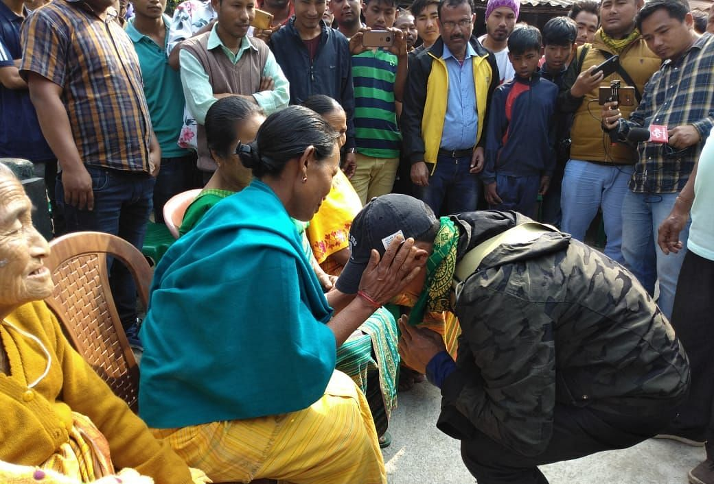 M Batha touching feet of elders as a mark of respect seeking blessings