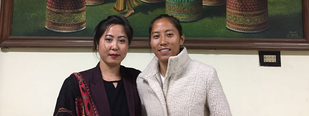 Footballer N Bala Devi (right) with her twin sister Nandi Leima in Imphal on Friday