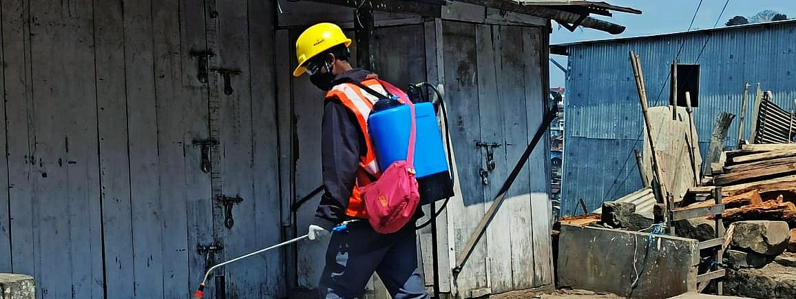 A sanitation worker is seen spraying disinfectant in Kohima on Wednesday