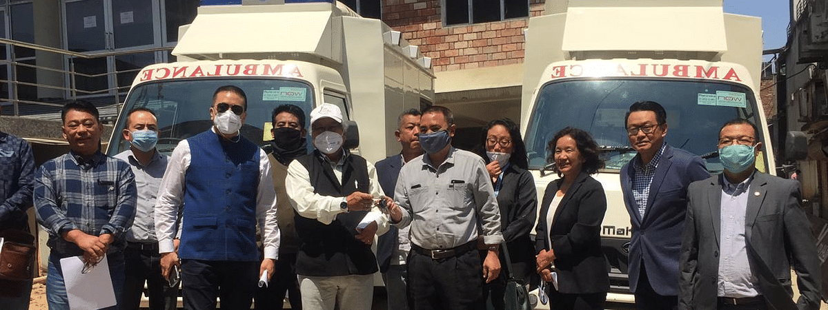 Senior officers of Kohima Smart City Development Limited handing over the keys of two new paramedic vehicles to the officers of Naga Hospital Authority Kohima