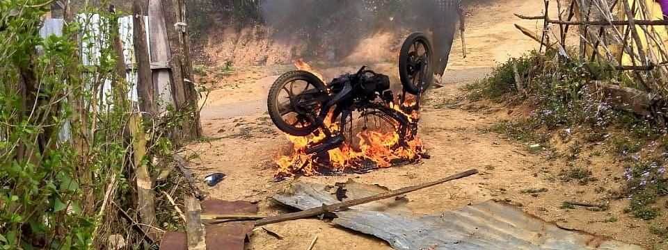 A motorcycle being burnt down during the clashes in Chassad village of Manipur's Kamjong district