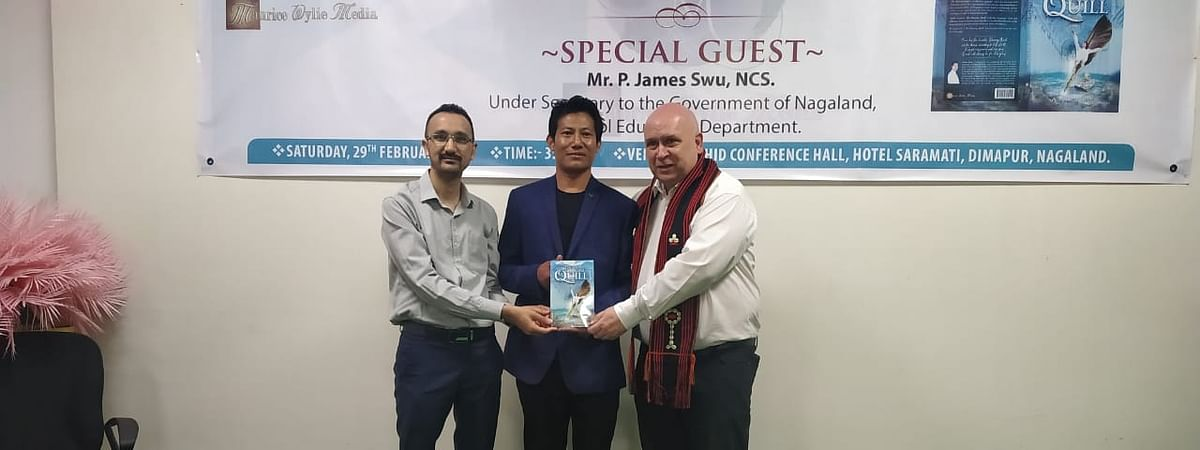 A Anato Swu and invitees posing for a picture after the book release in Dimapur on Saturday