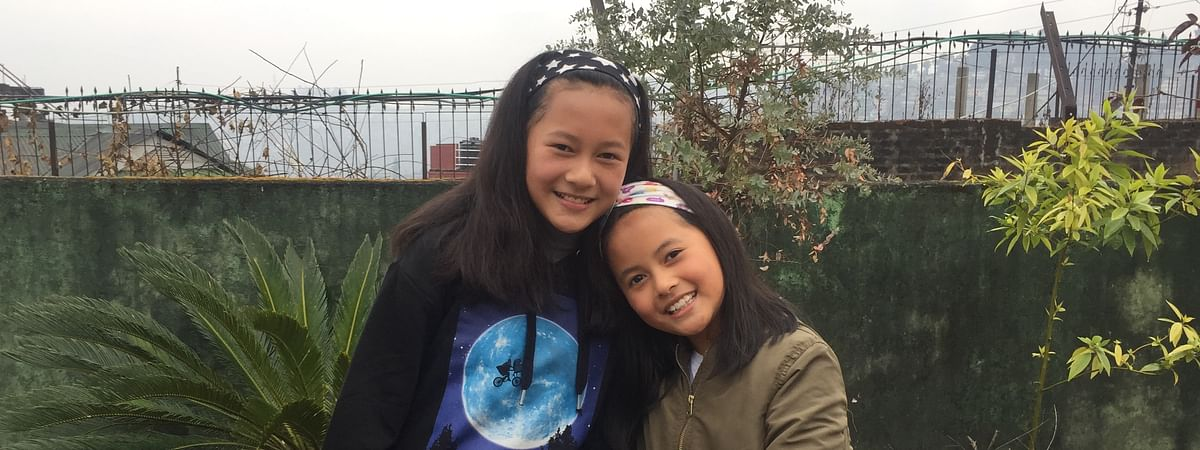 12-year-old Jentina Yaomei Shangkhu (left) and her nine-year-old sister Kirennaro Leesha Shangkhu in Kohima