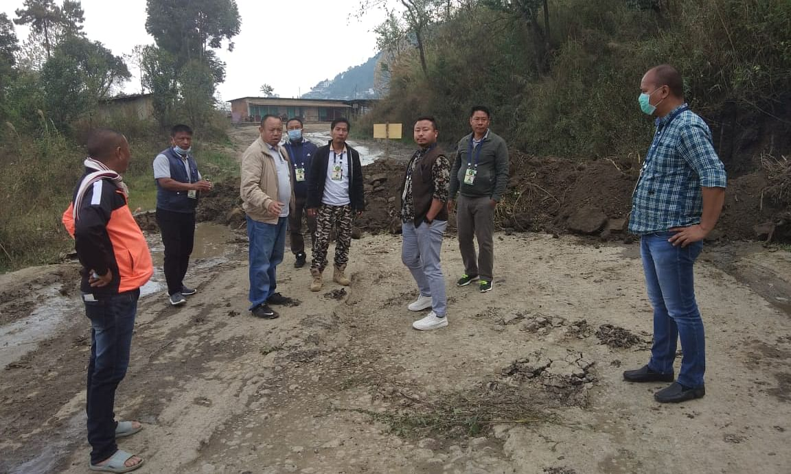 Locals along the National Highway 29 at Khuzama under Kohima district of Nagaland on Wednesday