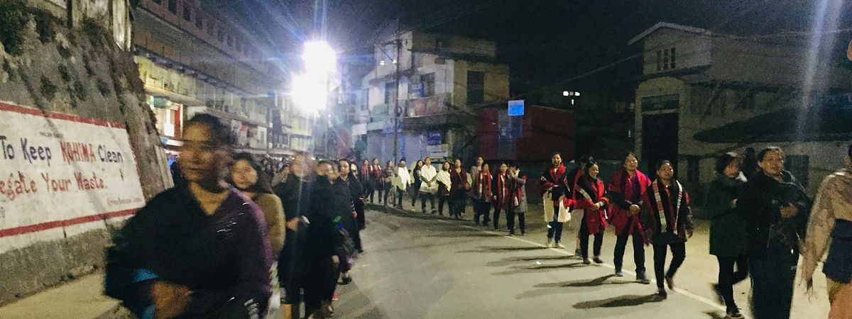 Forming two long lines, hundreds of women, most of whom adorned a piece of traditional attire, participated in the night walk at Kohima in Nagaland on Sunday
