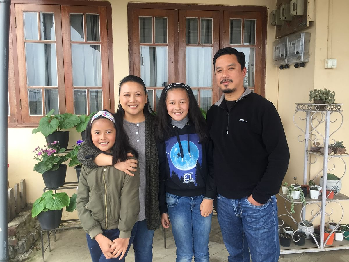 Jentina  and  Kirennaro with their parents in Kohima