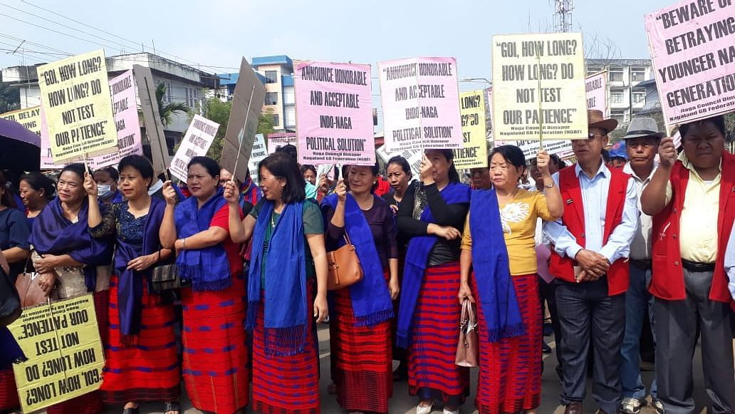 Women holding placards and showing support for an immediate solution to the Naga political talks from the Centre at a rally in Dimapur on Monday