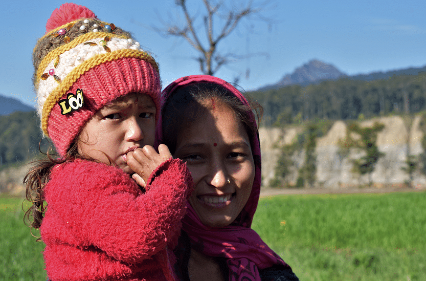 Meena Sawant with her daughter. The bank erosion was distinctly seen from her house
