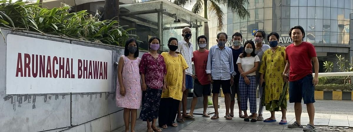 Okie Sancho (R) along with the patients and their attendants residing at Arunachal House in Mumbai