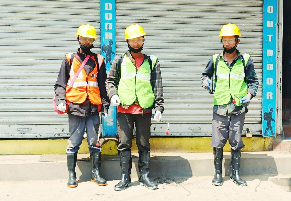 Sanitation workers pose amid the drive on Wednesday
