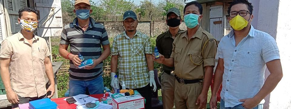 Rimmo Lollen and his team from Divine Child Health and Education (NGO) distributing hand sanitisers, masks and refreshment at a police post at Pasighat