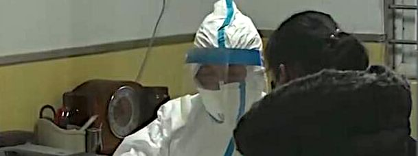 A healthcare worker wearing a protective suit during the wake of coronavirus pandemic