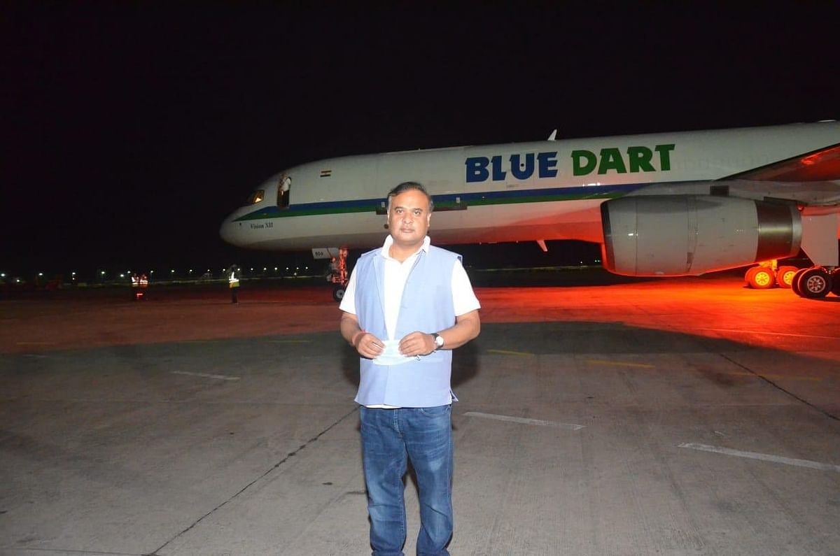 Minister Sarma stands near the special Blue Dart aircraft carrying the PPE kits for Assam