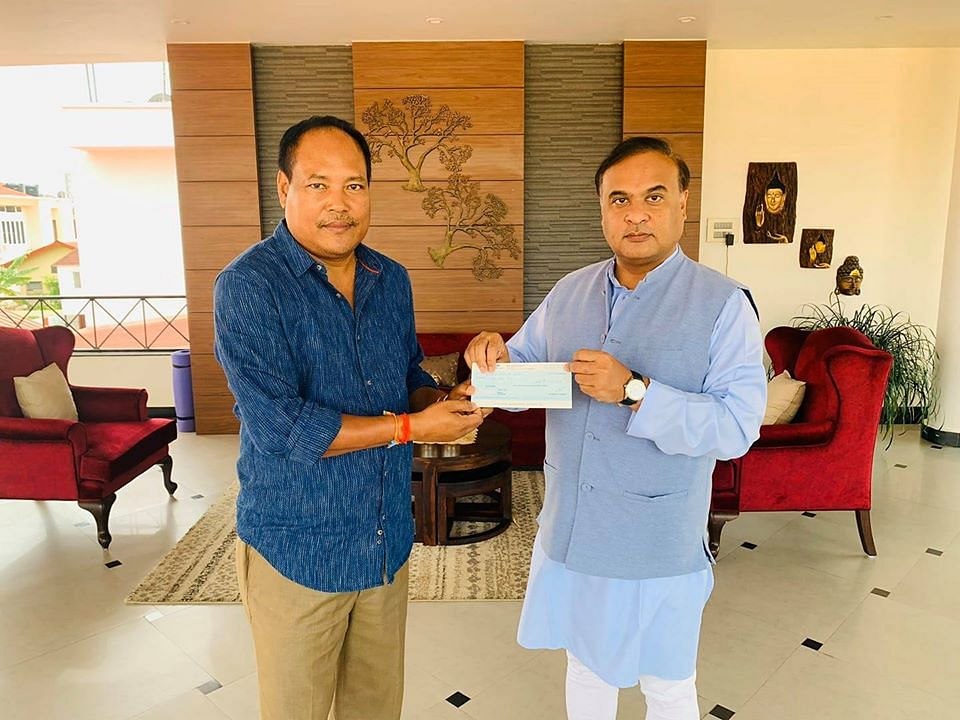 MP Biswajit Daimary handing over the cheque to Assam health minister Himanta Biswa Sarma
