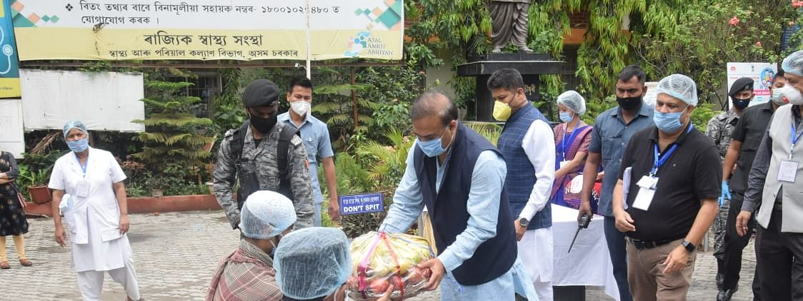 Assam health minister Himanta Biswa Sarma with the discharged patients