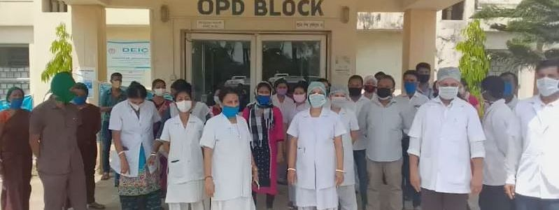 Doctors, nurses and other medical  staff of the Unakoti district hospital staging a demonstration in front of the OPD block on Wednesday