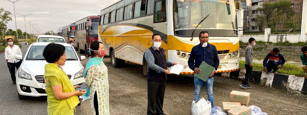 The four buses being sent off in Imphal for Guwahati on Wednesday