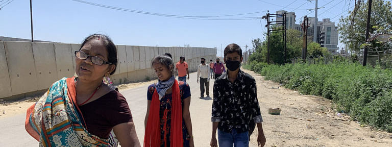 Migrants walk from Delhi to their homes in Ghaziabad after the national COVID-19 lockdown was imposed