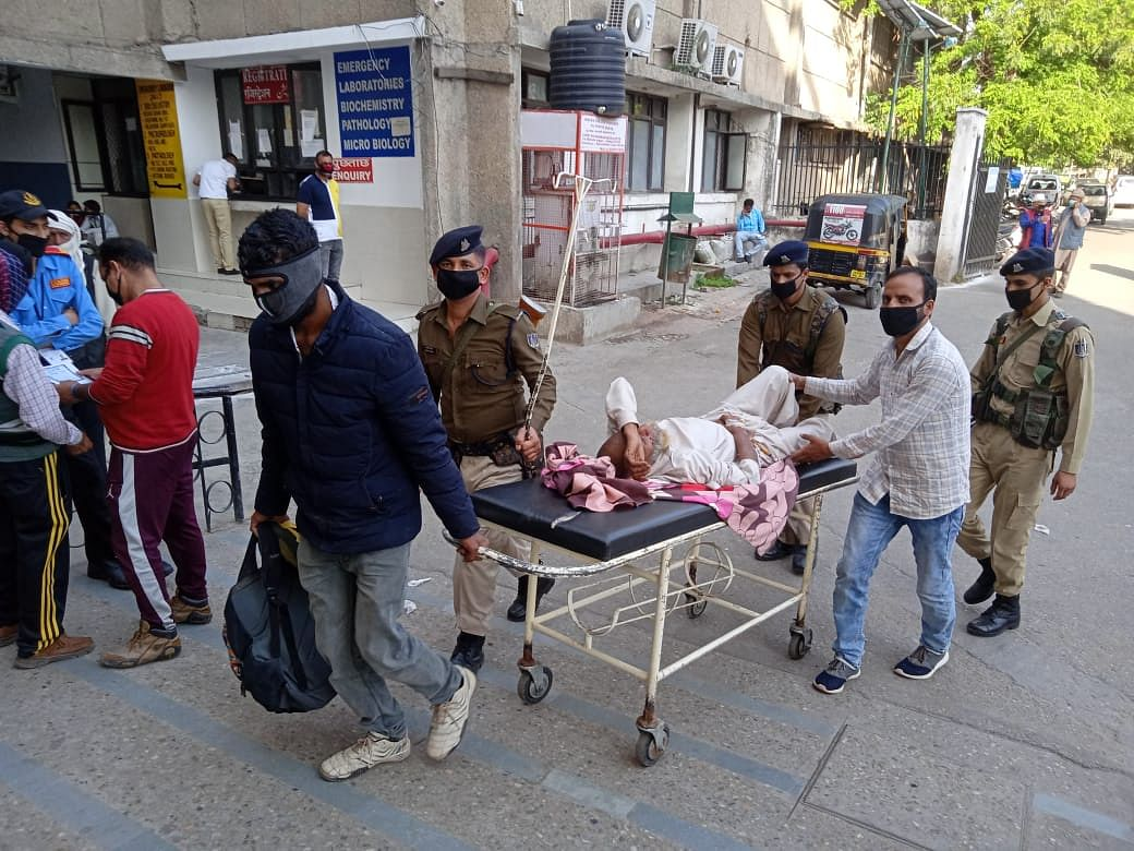 Arif's father Wazir being brought to the Government Medical College in Jammu