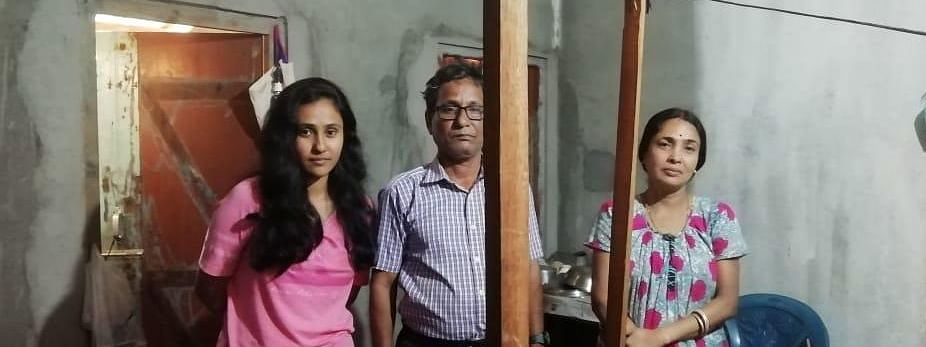 Shibram Kar (middle) with his wife (right) and daughter at a rented house in Guwahati