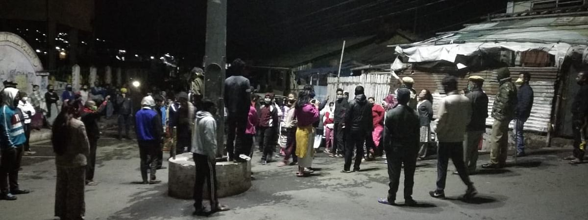 Residents of Jhalupara in Shillong gather to stop the cremation of Bethany Hospital doctor who died due to coronavirus on Wednesday