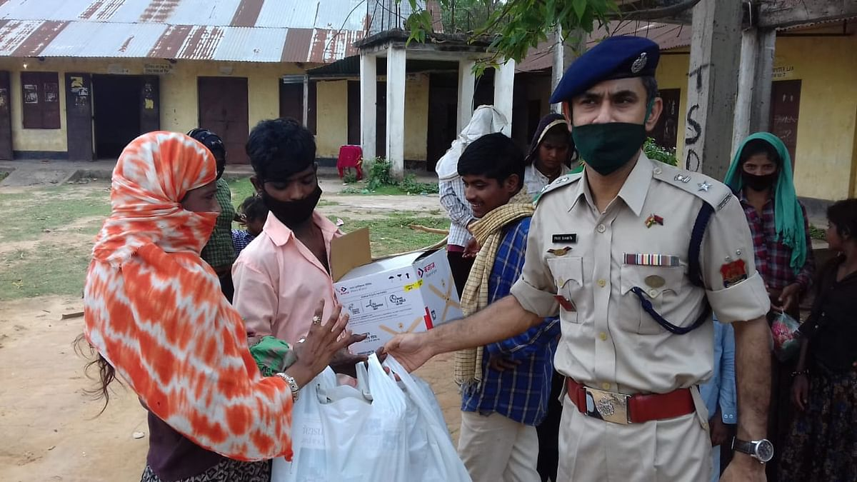 GRP Superintendent of Police, Pinaki Samanta handing over nutritional supplements, medicines and other necessary items to the stranded couple on Saturday