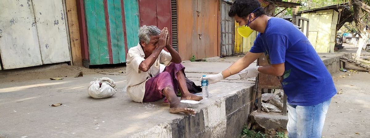 Members of Development Concern Intl (DCI) under its 'humanitarian support programme' are offering food to the needy people in Guwahati