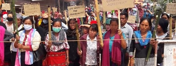 Local women standing guard to prevent troops of Assam Riffles to move beyond Kashung Bungbung village in Ukhrul district on Thursday
