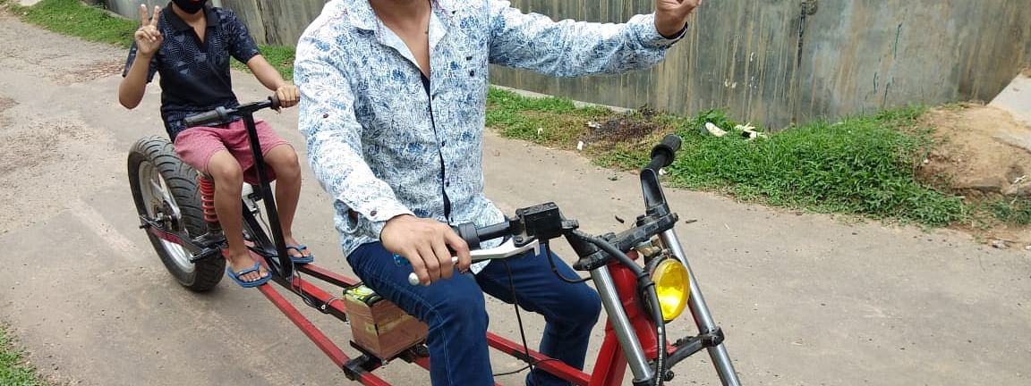 Partha Saha riding COVID-19 in Aralia village. The e-bike has a range of 80 km and takes 3-4 hours to fully charge
