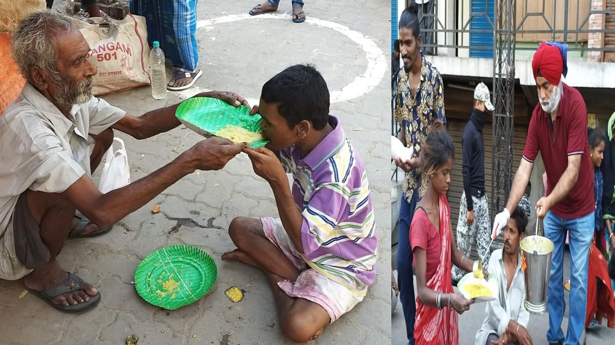 A father helping his son to have the <i>langar </i>provided by the Khalsa Centre North East