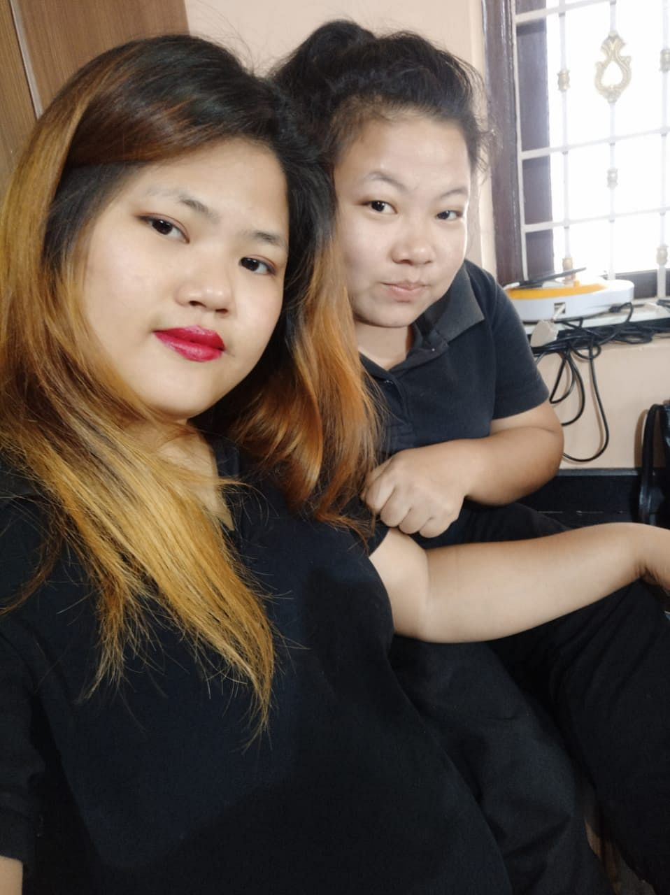 Grace and her colleague at Asian Continental Spa and Salon in Tamil Nadu