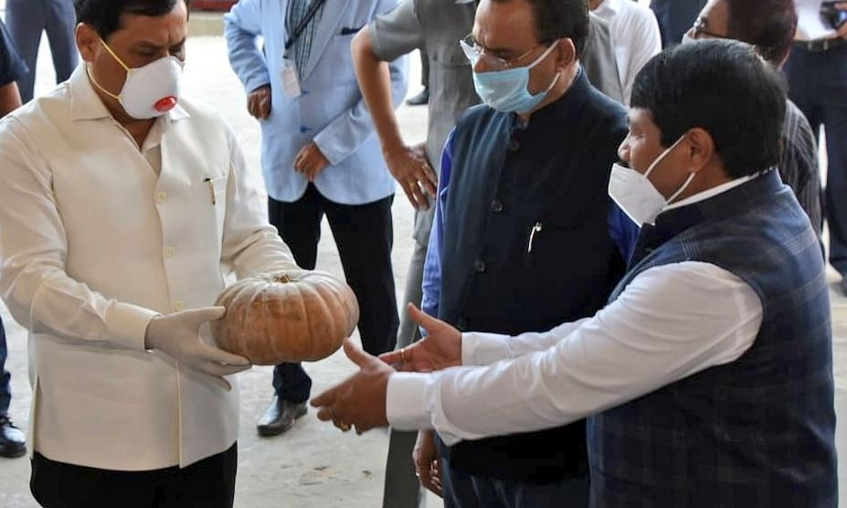 Assam CM Sarbananda Sonowal admiring the quality of the pumpkins with two of his senior Cabinet colleagues at LGBI Airport in Guwahati on Thursday